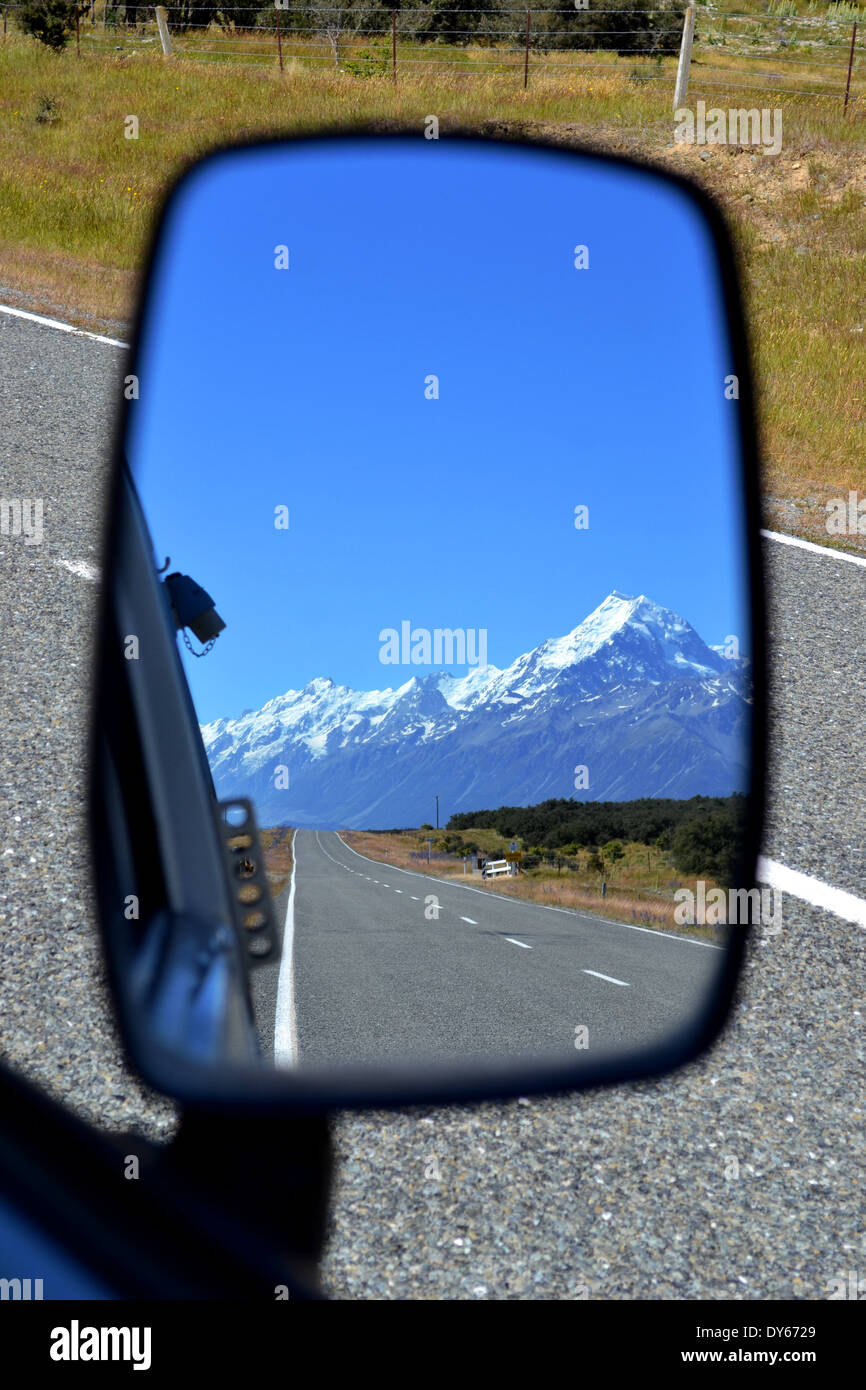 Reflection of Mount Cook and the road leading to it in a campervan wing mirror - Stock Image