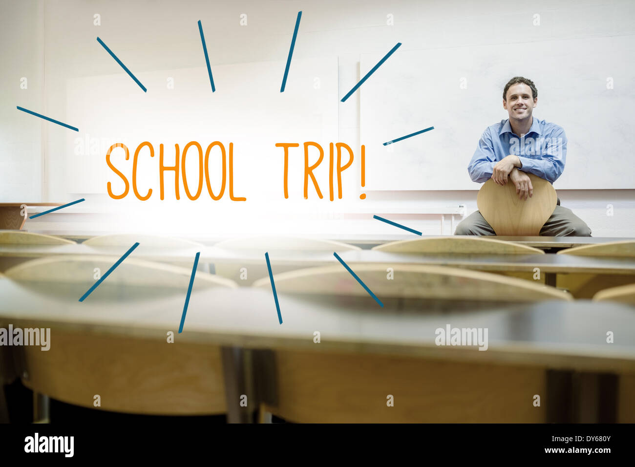 School trip! against lecturer sitting in lecture hall - Stock Image