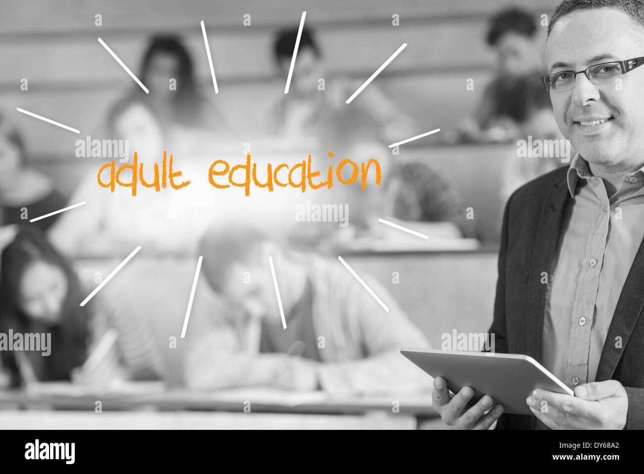 Adult education against lecturer standing in front of his class in lecture hall - Stock Image