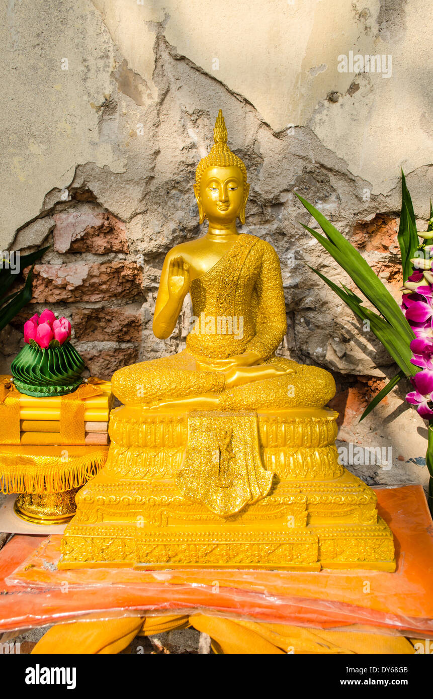 Golden Buddha statue in temple at thailand Stock Photo