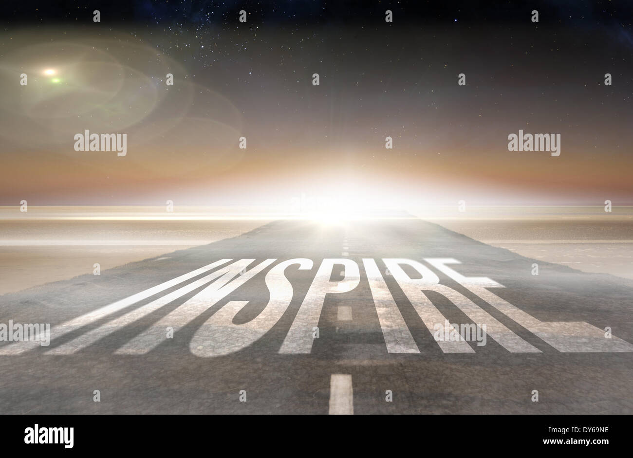 Inspire against road leading out to the horizon - Stock Image