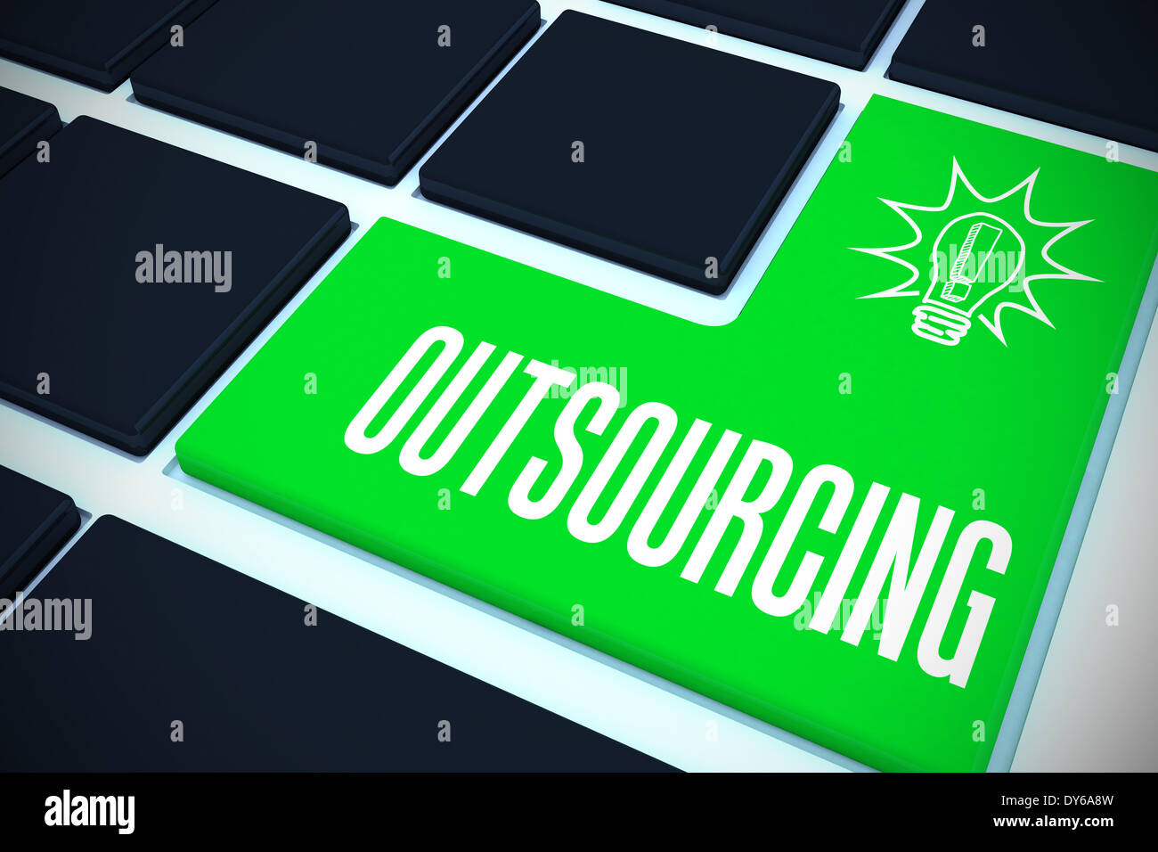 Outsourcing on black keyboard with green key - Stock Image