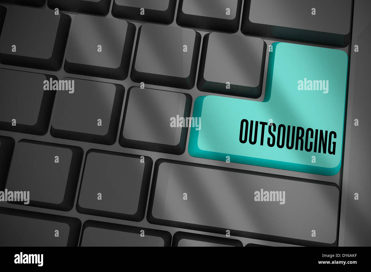 Outsourcing on black keyboard with blue key - Stock Image
