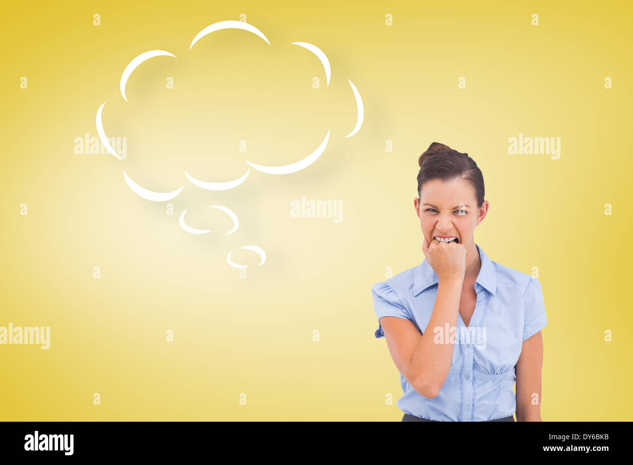 Composite image of furious businesswoman looking at the camera with speech bubble - Stock Image