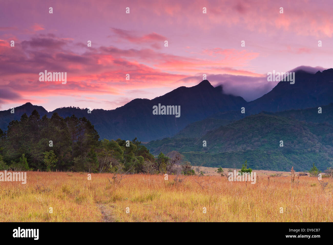 Colourful skies at dawn over Volcan Baru (extreme right), 3475 m, in the Chiriqui province, Republic of Panama. Stock Photo