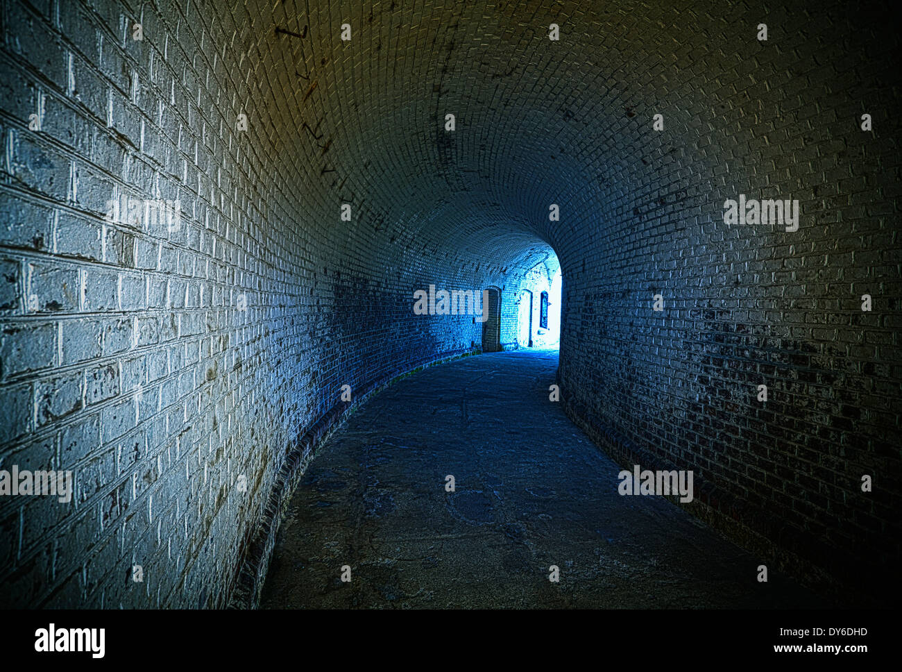 Old desolated tunnel with blue glowing effect, HDR processing. - Stock Image