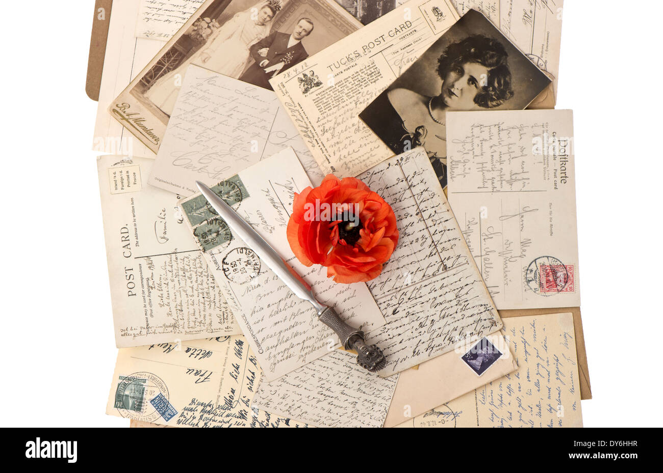 vintage background with old photos, post cards and antique letter opener - Stock Image