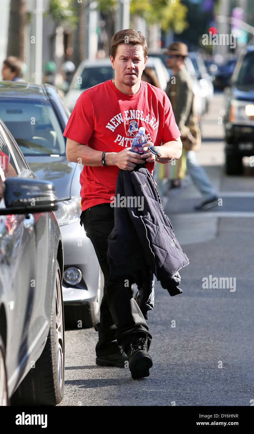 Mark Wahlberg and his wife leaving Jack and Gills restaurant in Beverly Hills after having lunch togetherFeaturing: Mark Wahlberg Where: Beverly Hills CaliforniaWhen: 13 Dec 2012 - Stock Image