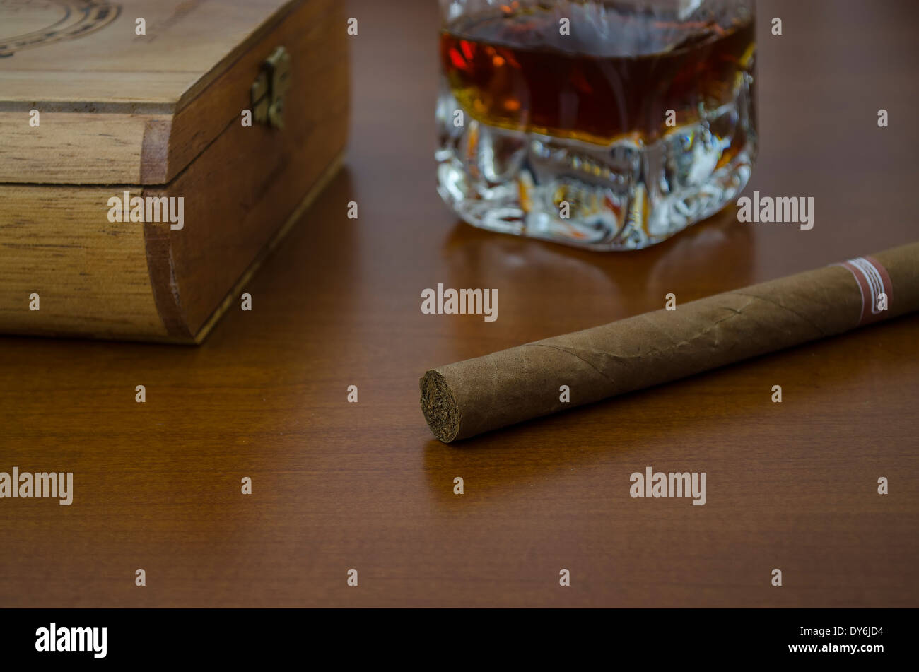 a cigar Havano first term and the bottom a box of cigars and a glass of whiskey - Stock Image