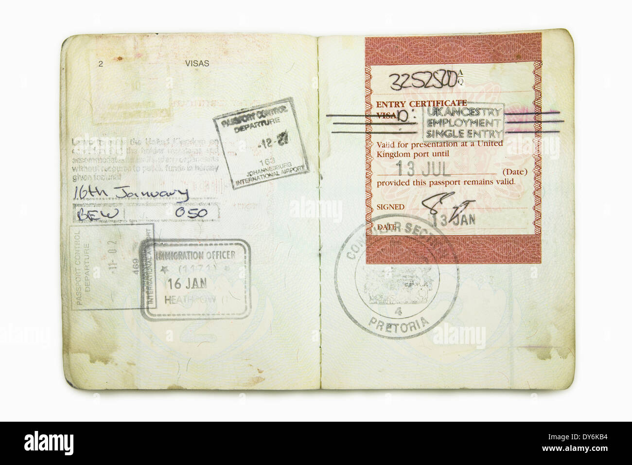 foreign passport with a British Immigration Visa stamps Stock Photo