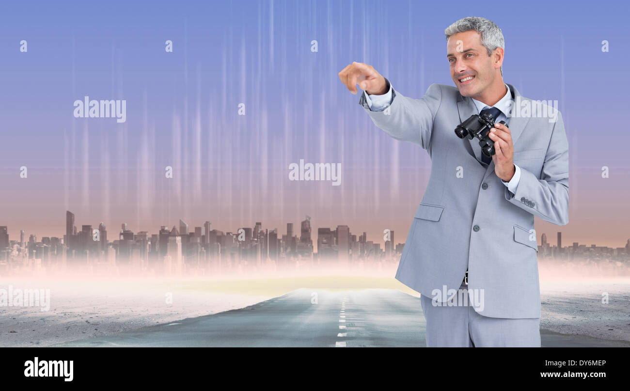 Composite image of businessman holding binoculars and pointing out something - Stock Image
