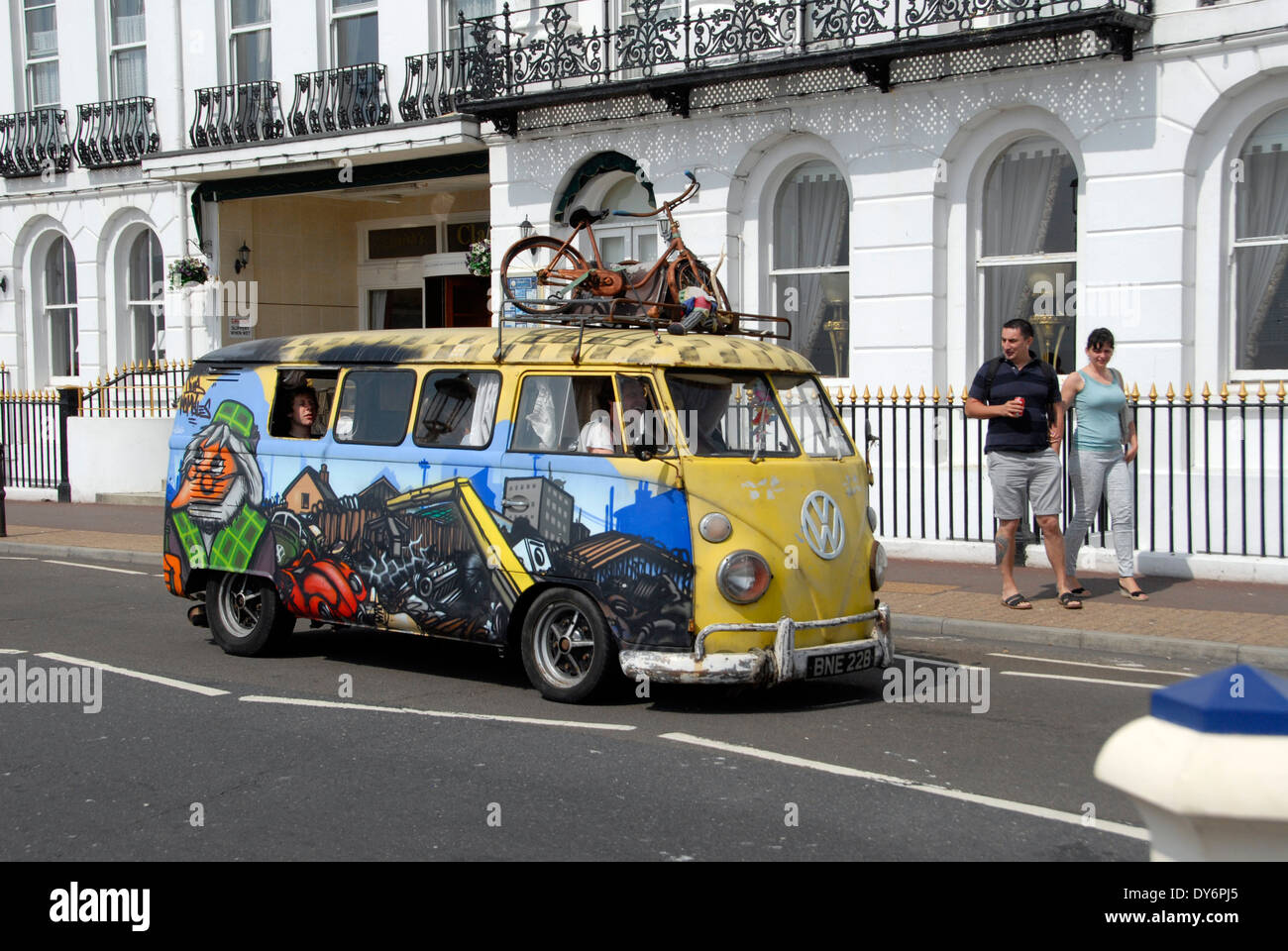 Classic VW camper van with painted exterior on Eastbourne seafront,  Sussex, England UK - Stock Image