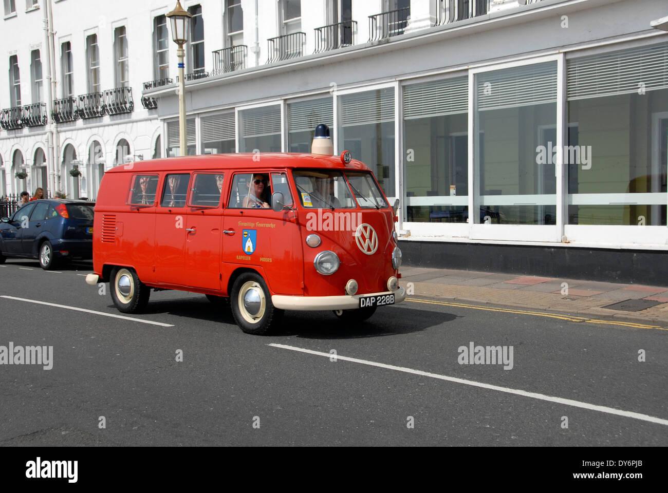 Classic VW camper van on Eastbourne seafront,  Sussex, England UK - Stock Image