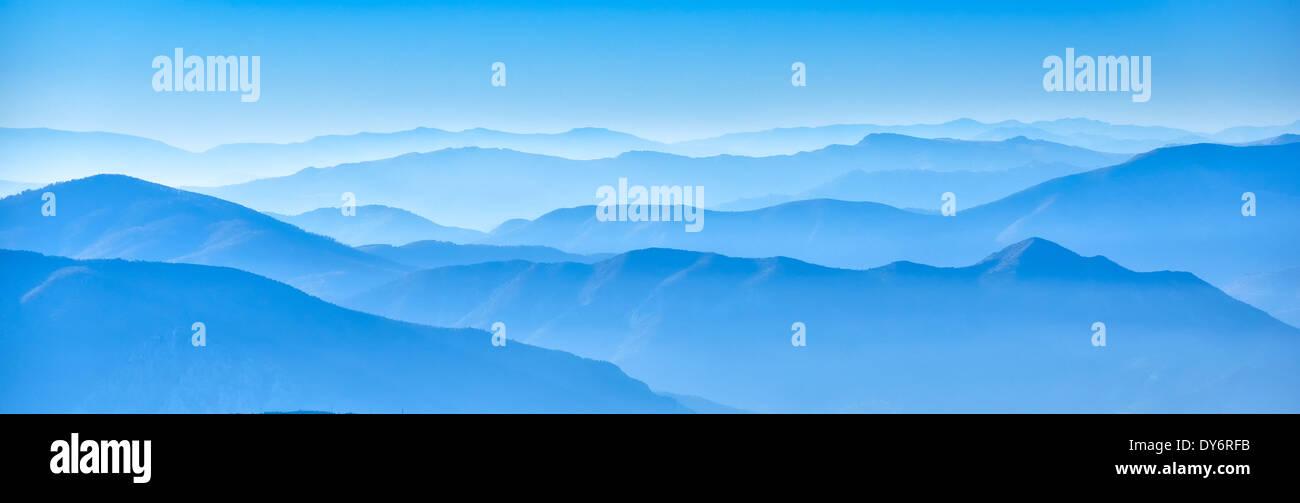 misty horizons blue tones - macedonian mountain - Stock Image