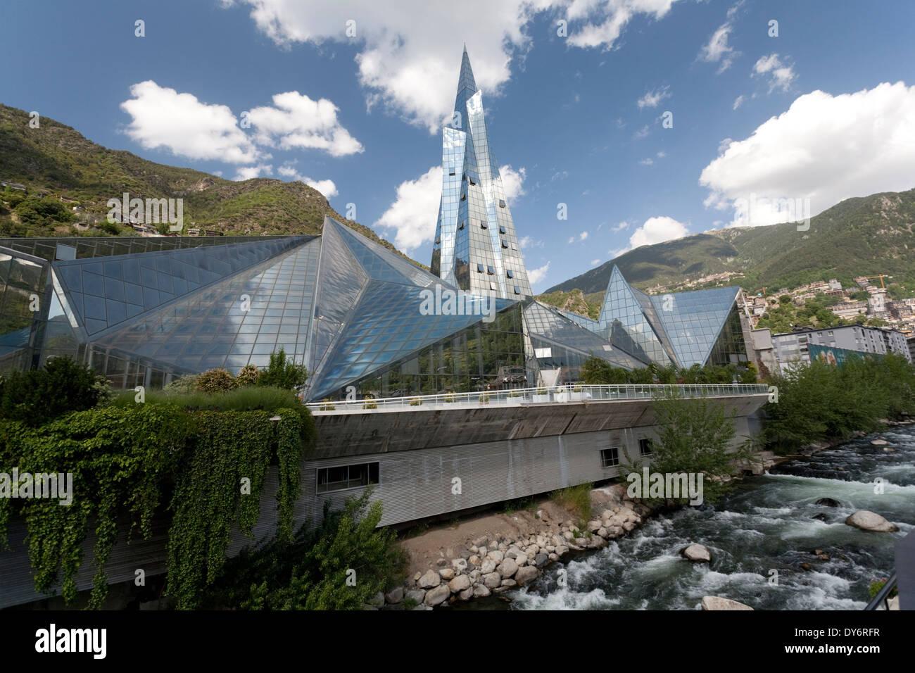 The glass covered spa Caldea and the River Valira in the country of Andorra la Vella - Stock Image