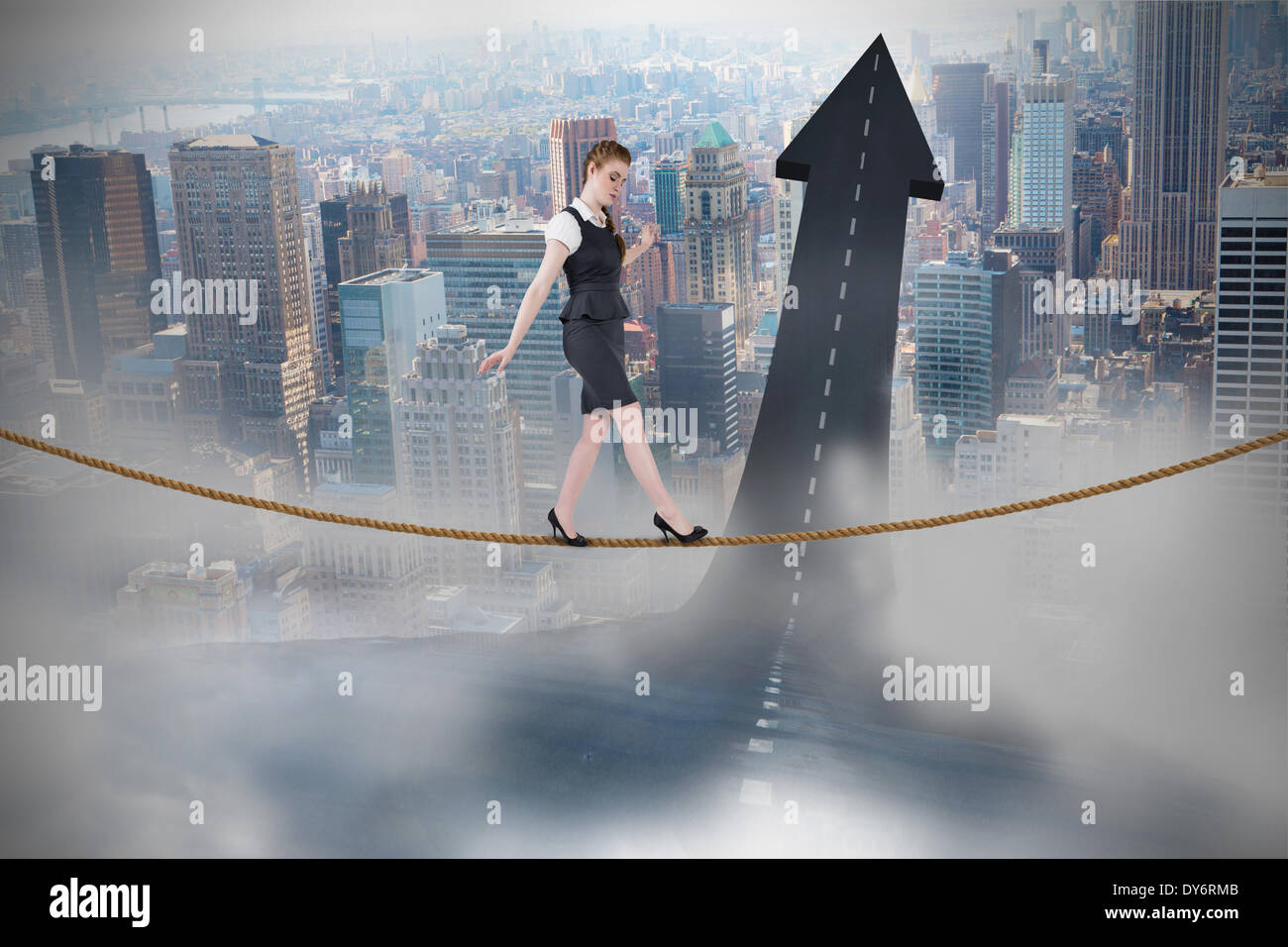 Composite image of businesswoman doing a balancing act - Stock Image
