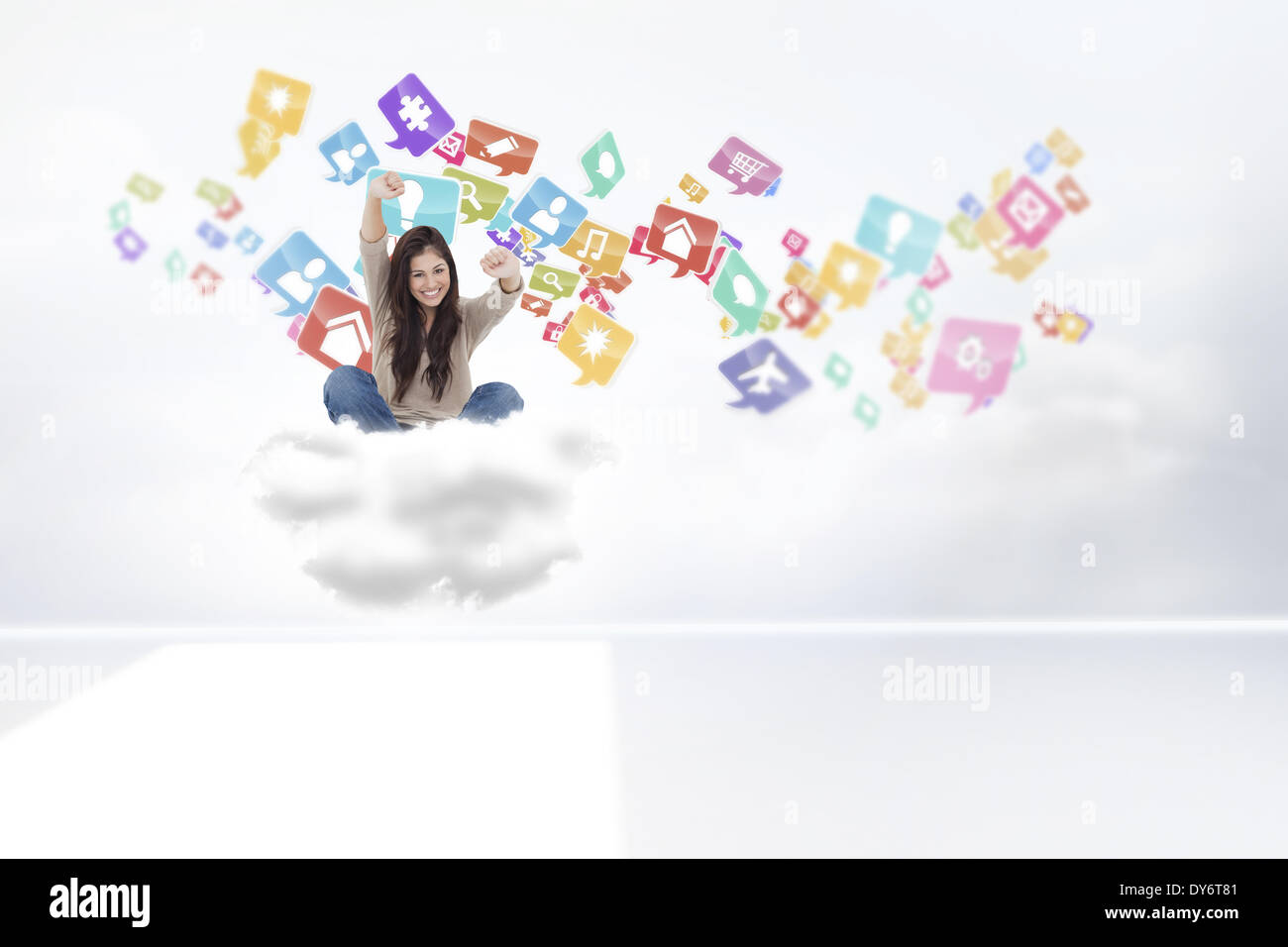 Composite image of woman looks straight ahead as she celebrates in front of her laptop - Stock Image