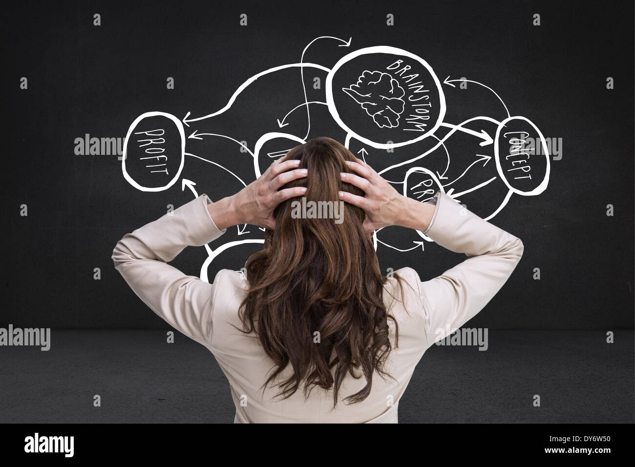 Composite image of young classy businesswoman with hands on head standing back to camera - Stock Image