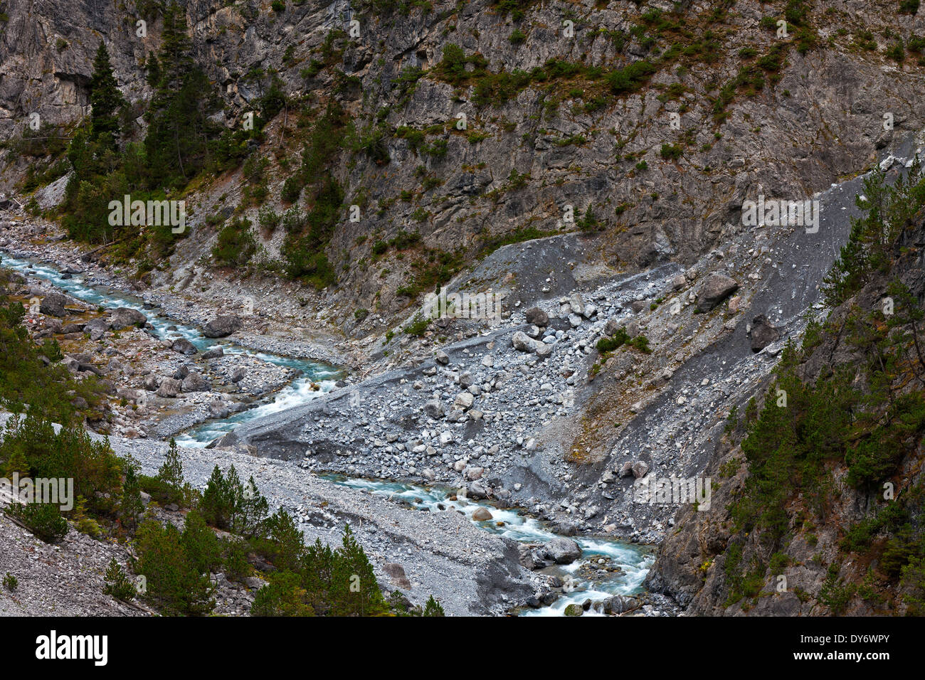 Mountain torrent running in Clemgia gorge in the mountains of the Swiss National Park at Graubünden / Grisons, Alps, Stock Photo