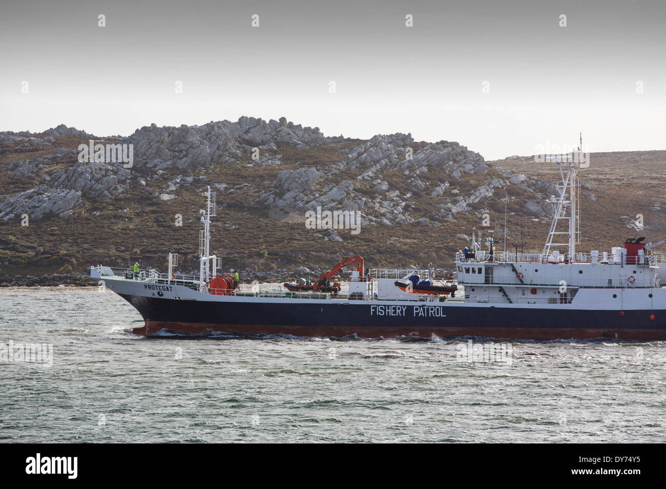 A Fisheries Patrol vessel leaves Port Stanley in the Falkland Islands, to patrol the territorial warers for illegal fishing. - Stock Image