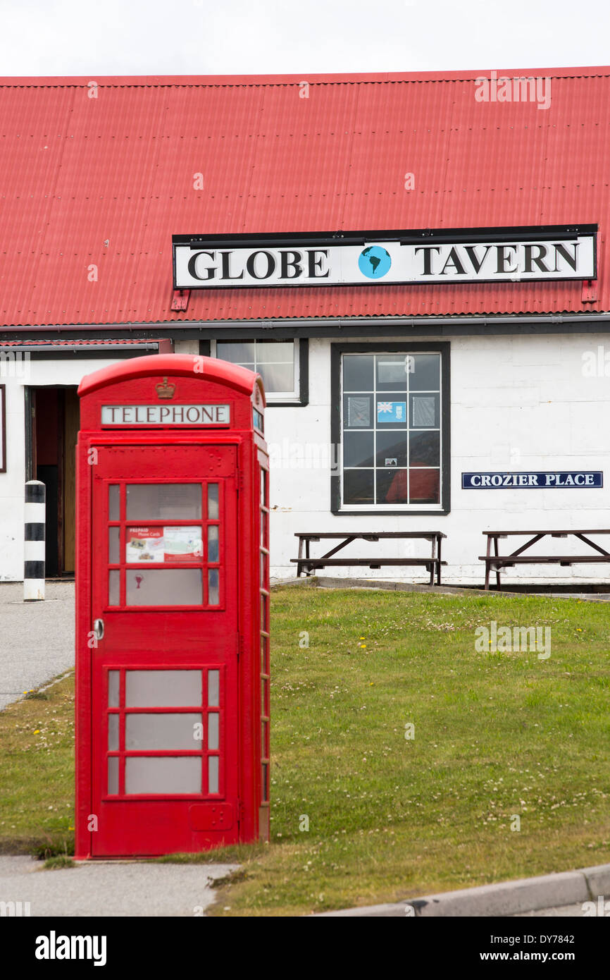 A pub and English phone box in Port Stanley, the capital of the Falkland Islands. - Stock Image
