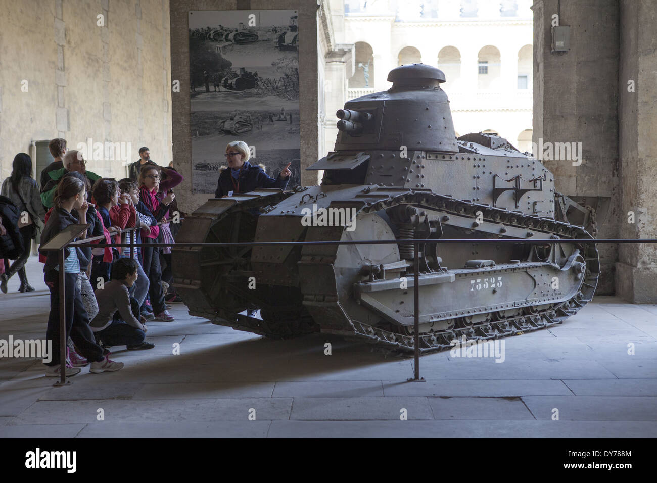 Teacher educating children about French tank at L'hospital des invalides Paris France - Stock Image