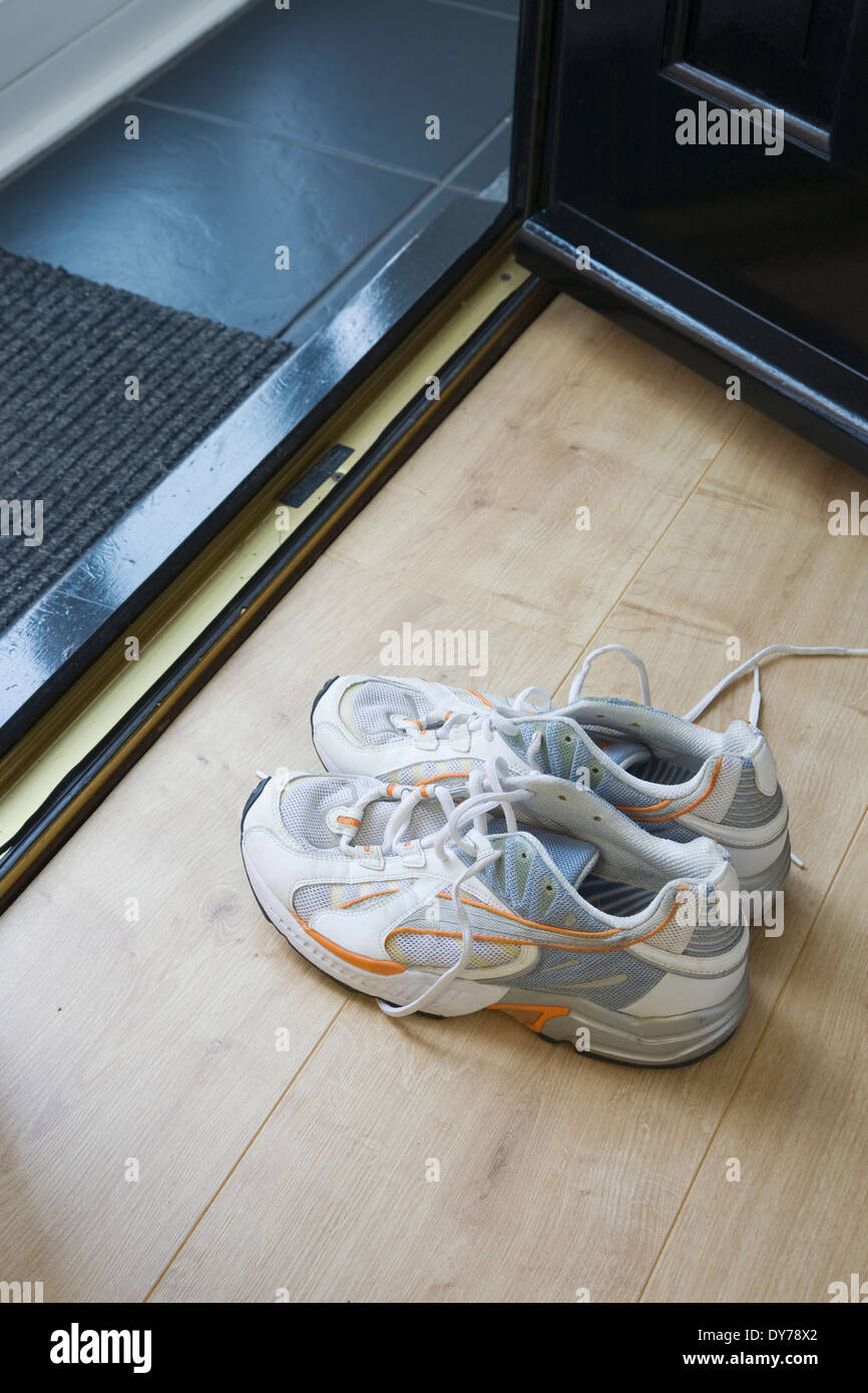 Sports Running Shoes By The Home Front Door