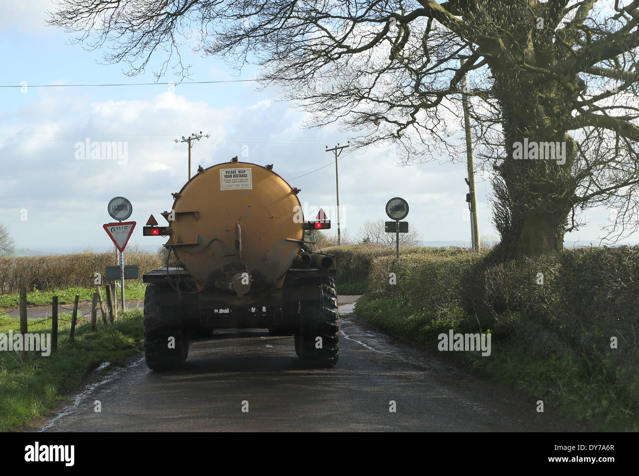 Agricultural sludge tanker filling a small rural road, April 2014 - Stock Image