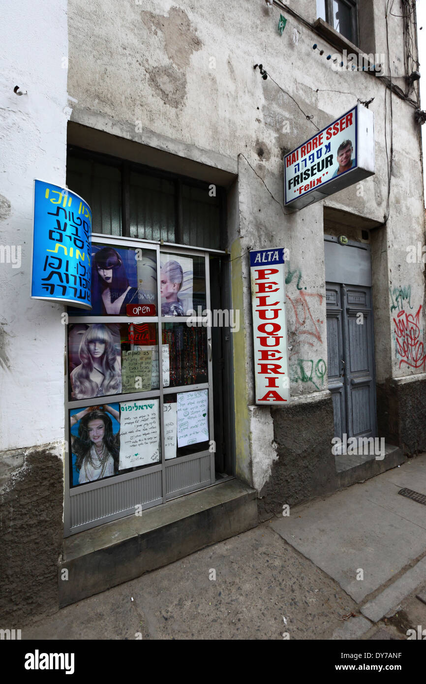 Signs in Hebrew to attract Israeli tourists on hairdressers, La Paz, Bolivia - Stock Image