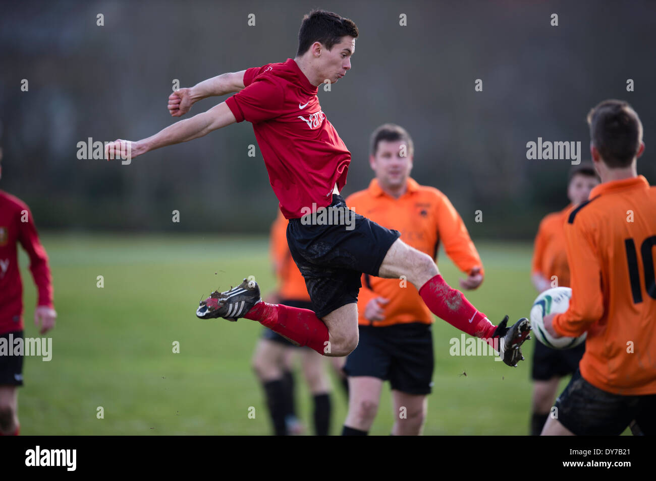 Amateur footballers playing non-professional soccer on a saturday afternoon in a park, UK - Stock Image