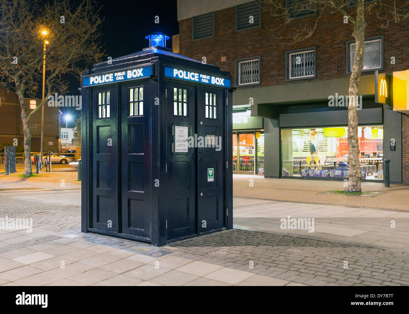 Boscombe, UK. 08th Apr, 2014. Night shot of the new police box which resembles the 'Tardis' from Dr Who which was unveiled today TUESDAY 8TH APRIL on Boscombe precinct by Bournemouth East MP Tobias Ellwood. It intended to help combat antisocial behaviour by providing a regular police presence in the antisocial behaviour hotspot. Credit:  Gregory  Davies/Alamy Live News - Stock Image