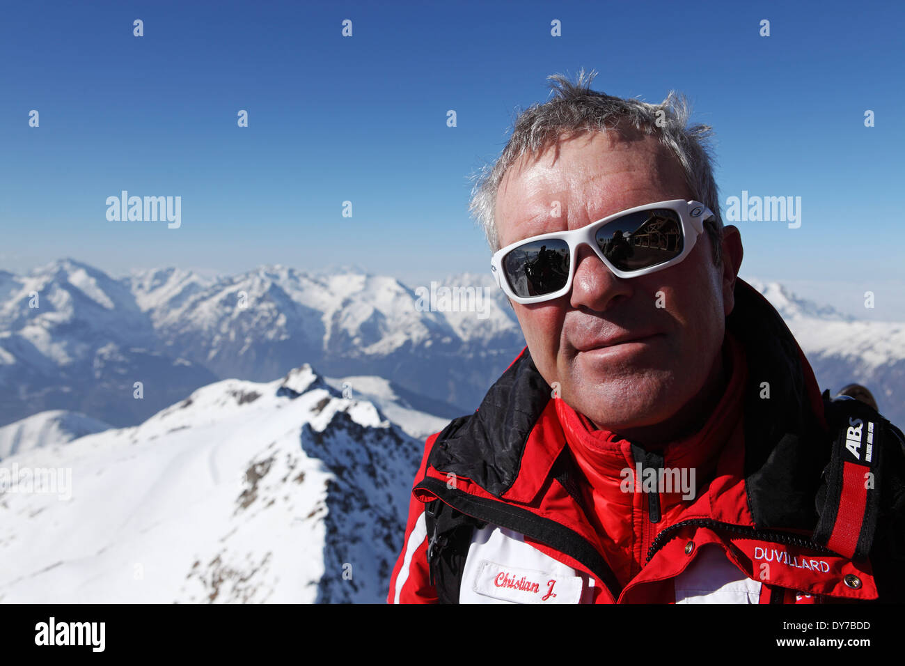 An ESF ski instructor at the Pic Blanc station at 3,300m in L' Alpe d'Huez, France. - Stock Image