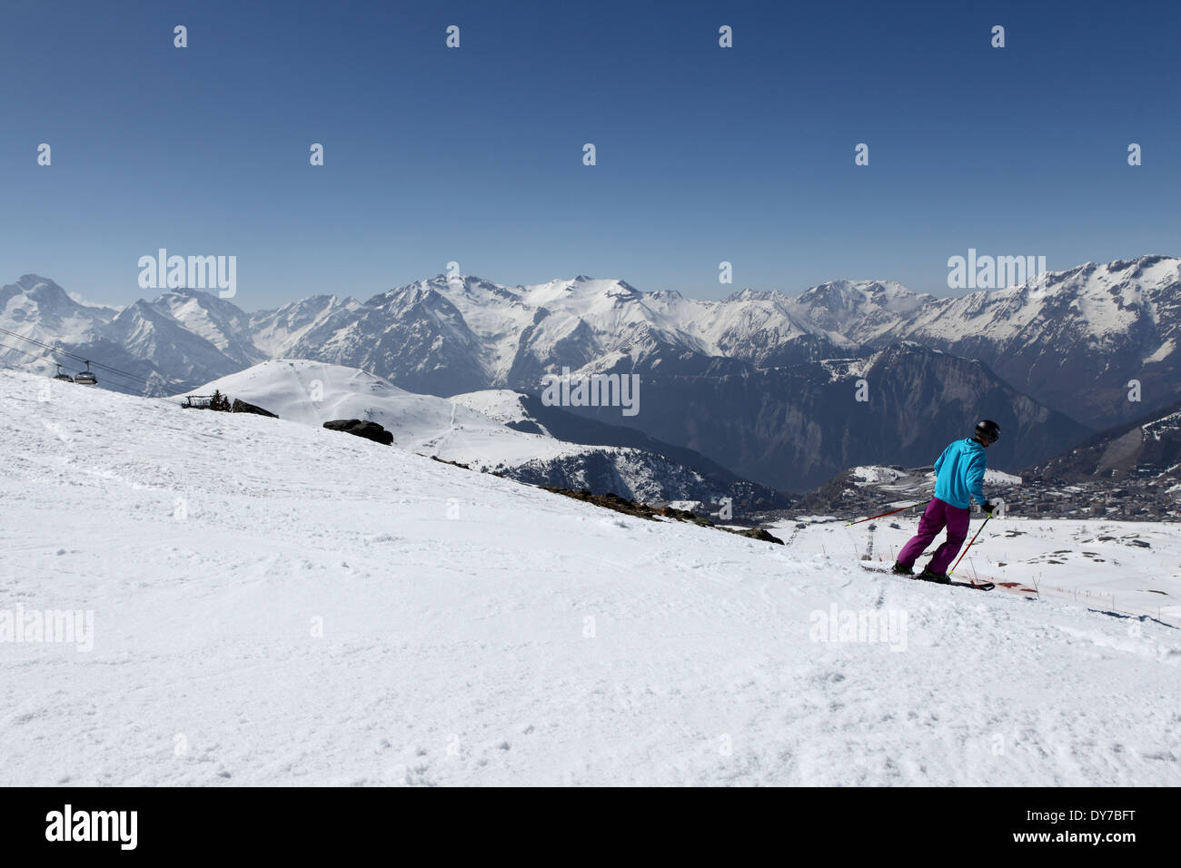A snow covered Alpine skiing piste at Alpe d'Huez, France. - Stock Image