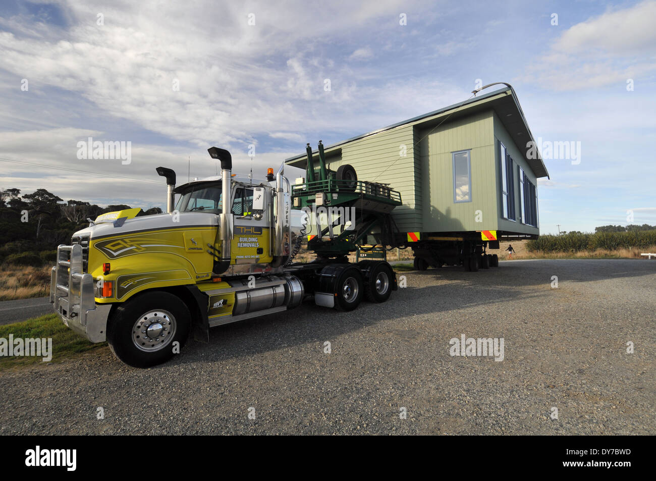 A house being towed by a truck, Curio Bay, South Island, New Zealand Stock Photo