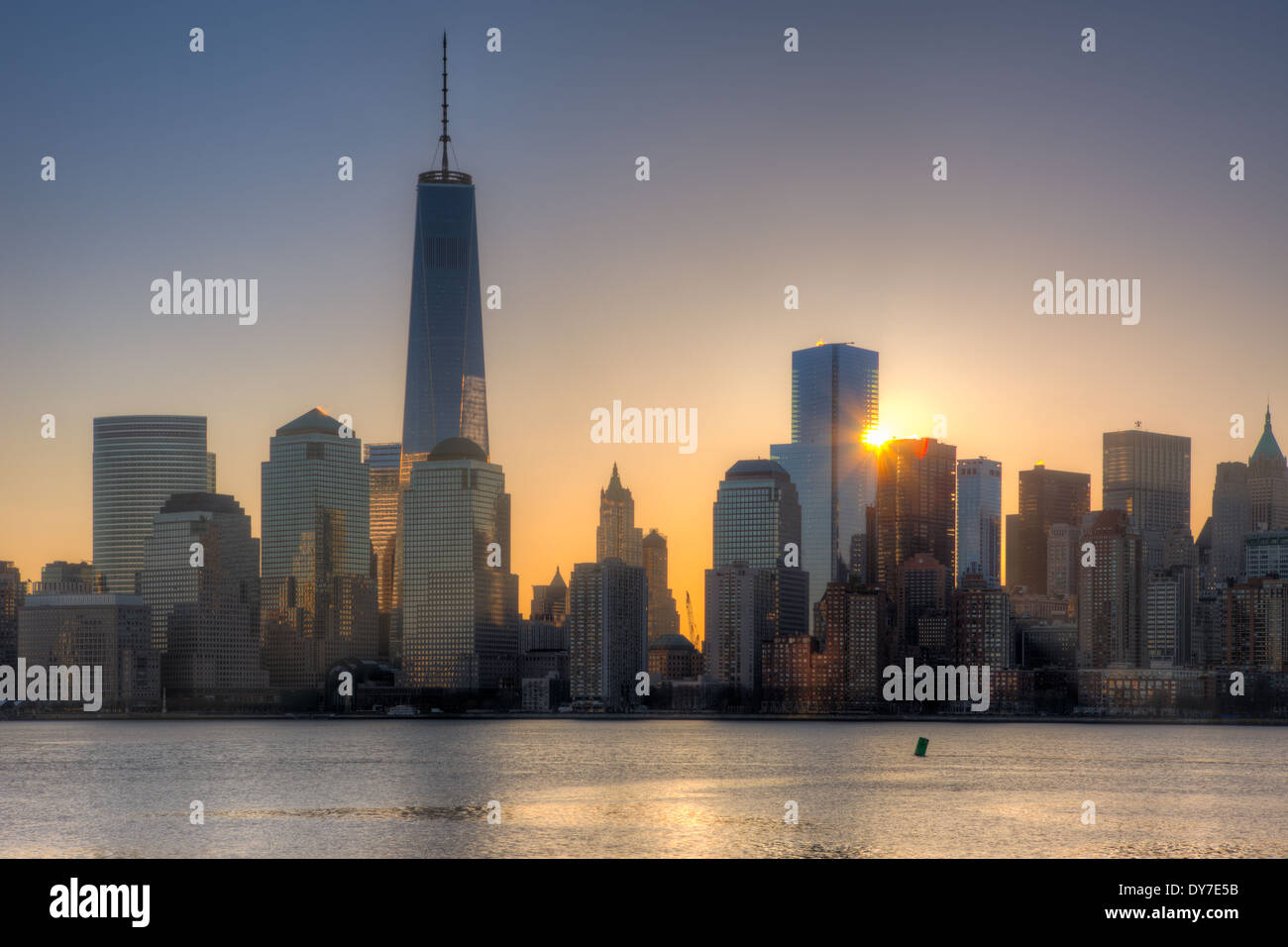 The sun rises next to 4 World Trade Center as the Freedom Tower (1 WTC) stands tall nearby in New York City. - Stock Image