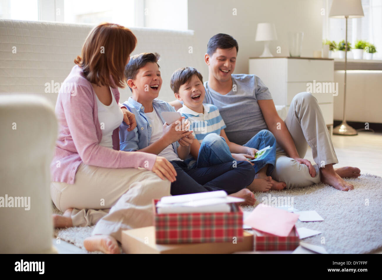 Portrait of friendly family spending time together at home - Stock Image
