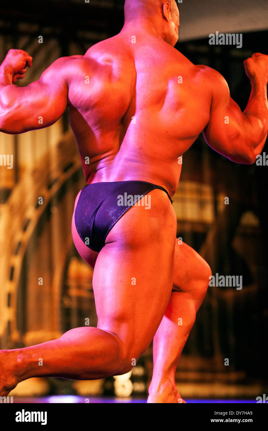 Detail of a male bodybuilder during the fitness fair FIBO in Cologne, Germany, 2014. - Stock Image