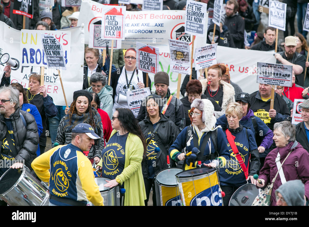 Protestors march through Manchester City Centre today (Sat 05/04/14) in opposition to the bedroom tax. - Stock Image