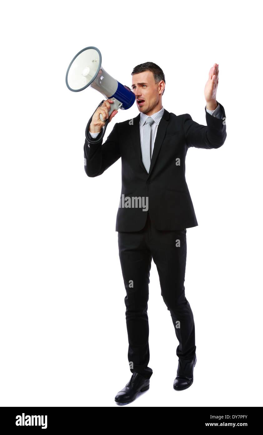 Full length portrait of businessman yelling through megaphone isolated on white background - Stock Image