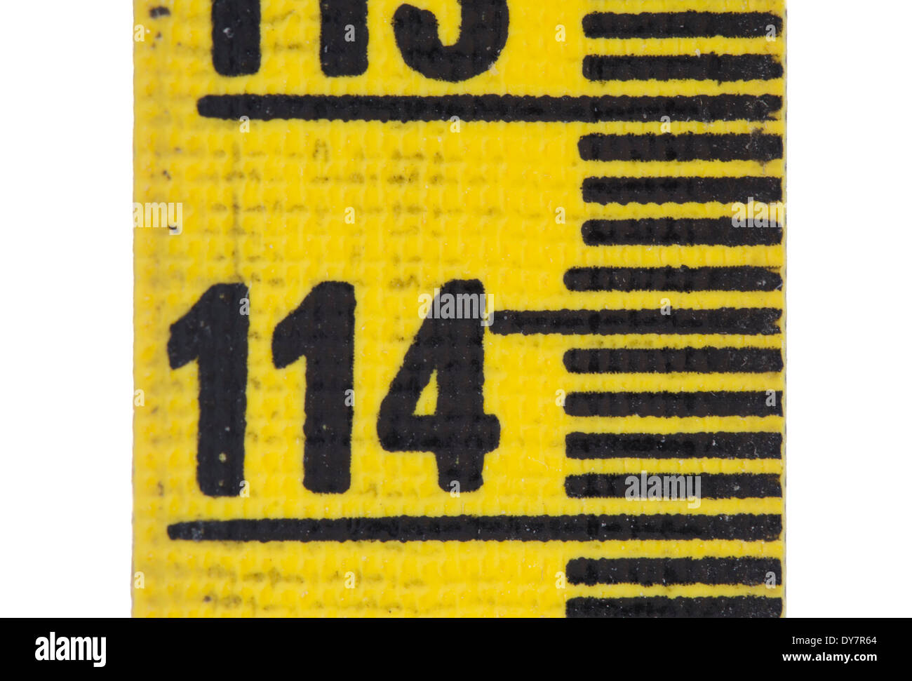 Closeup of a tatty yellow tape measure - Stock Image