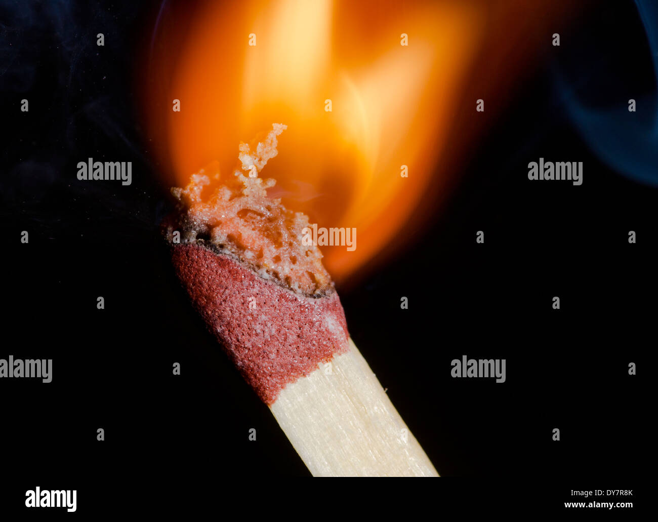 Match igniting on a black background. - Stock Image