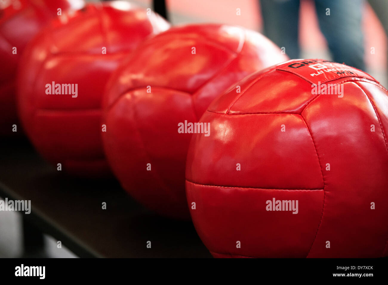 Red gymnastic balls on the fitness fair FIBO in Cologne, Germany, 2014. - Stock Image