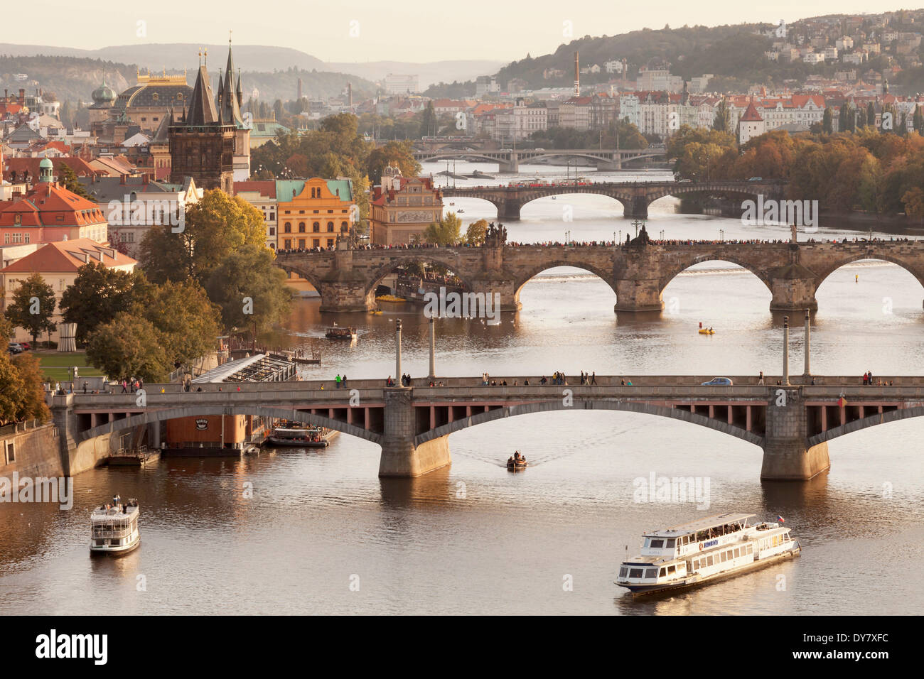 View from Letna hill over the Vltava River with its bridges to the Old Town with the historic Old Town Bridge Tower, Prague - Stock Image