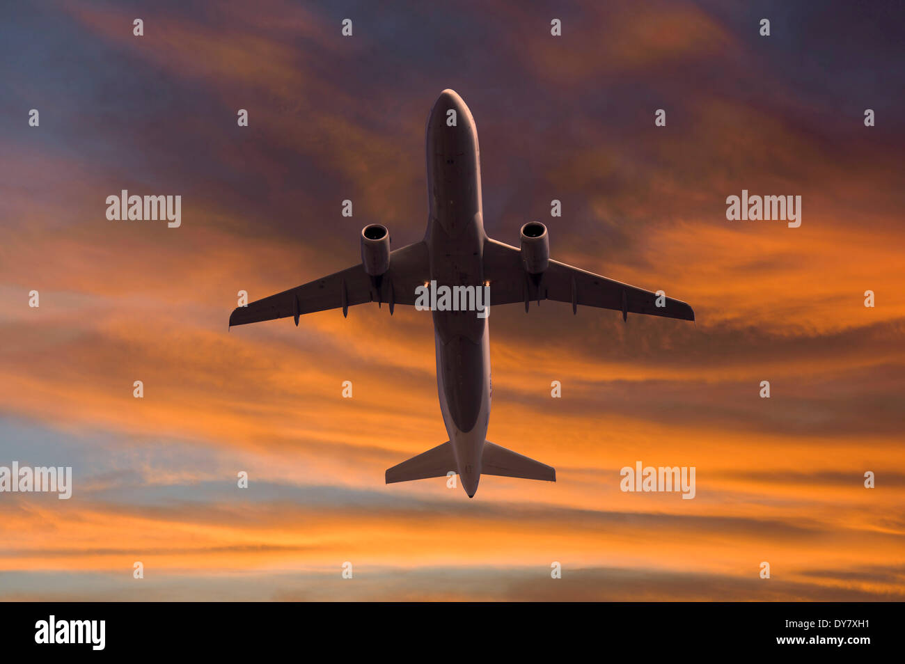 Lufthansa Airbus in flight, from below, in the evening light - Stock Image