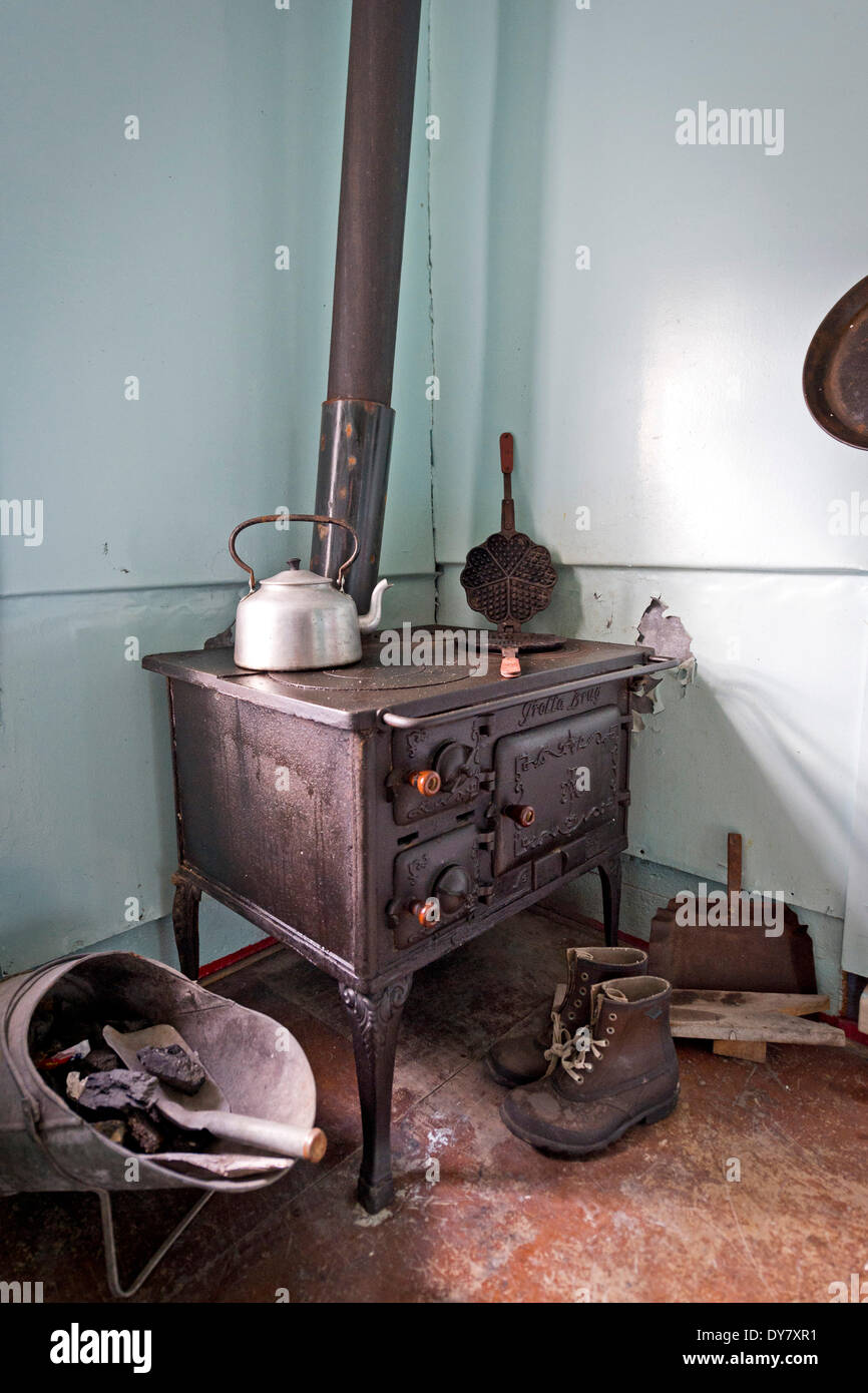 Old stove, house of the coal company, now a museum, Ny-Alesund, Spitsbergen, Svalbard Islands, Svalbard and Jan Mayen, Norway - Stock Image