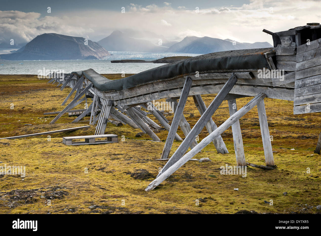 Old water pipeline, on stilts above ground because of the permafrost, Kongsfjorden, Ny-Alesund, Spitsbergen, Svalbard Islands - Stock Image