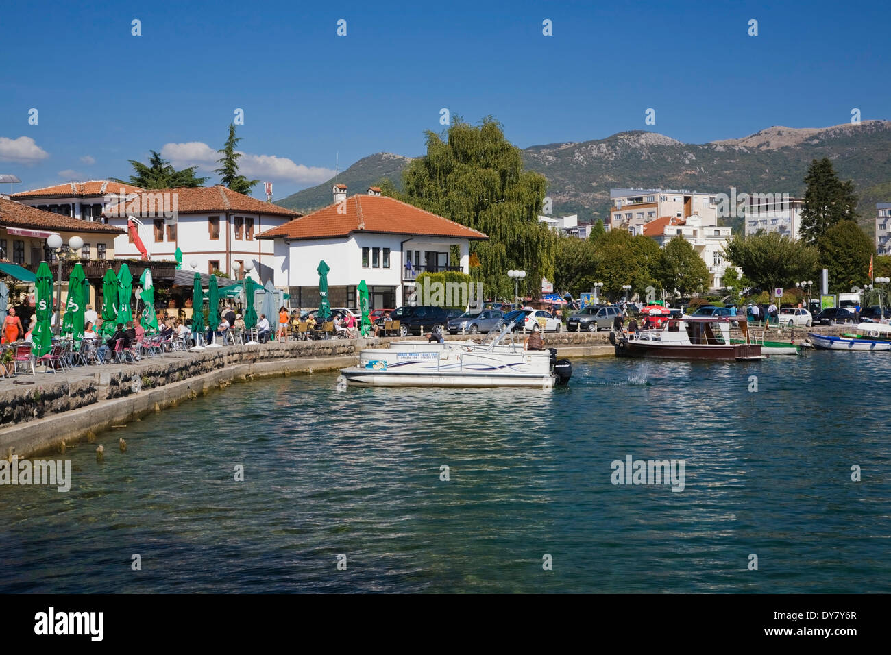 Waterfront and boats moored in Ohrid harbour on Lake Ohrid, Ohrid, Macedonia Stock Photo