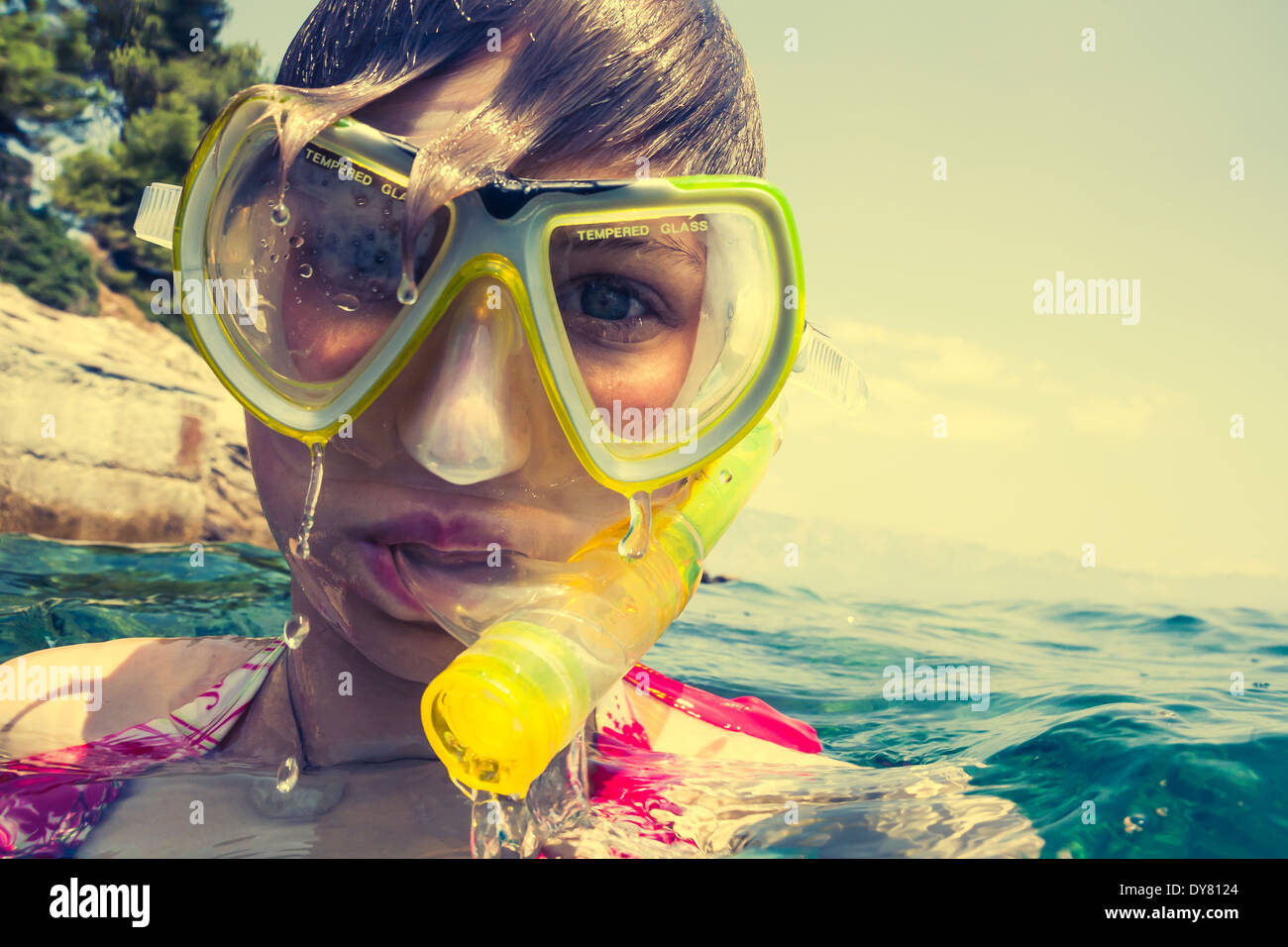 Croatia, Brac, Sumartin, Teenage girl in water with diving goggles and snorkel Stock Photo