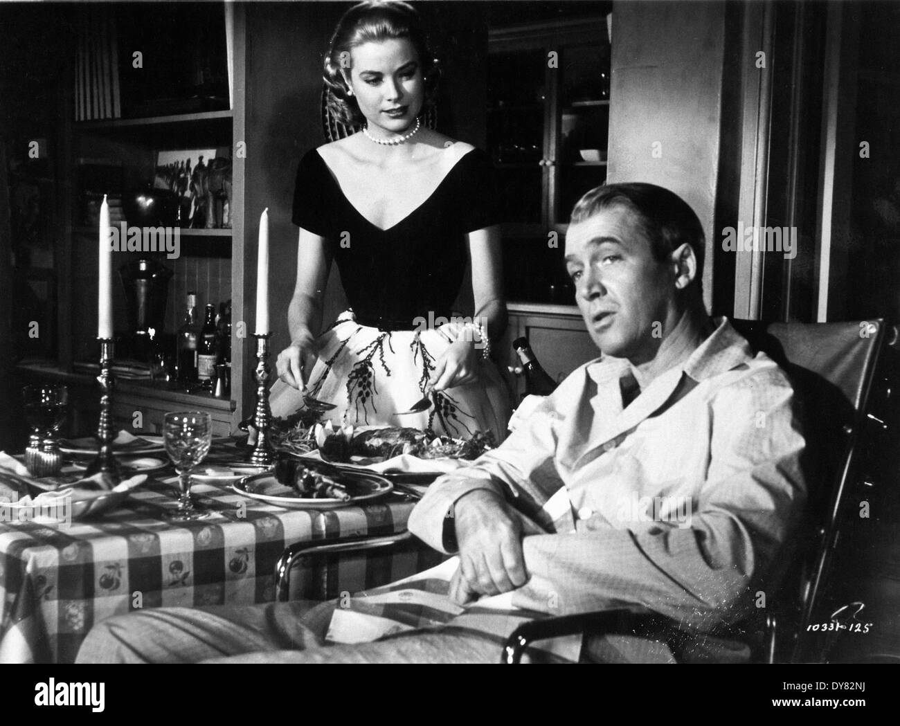 Rear Window - Grace Kelly , James Stewart - Director : Alfred Hitchcock - 1954 - Stock Image
