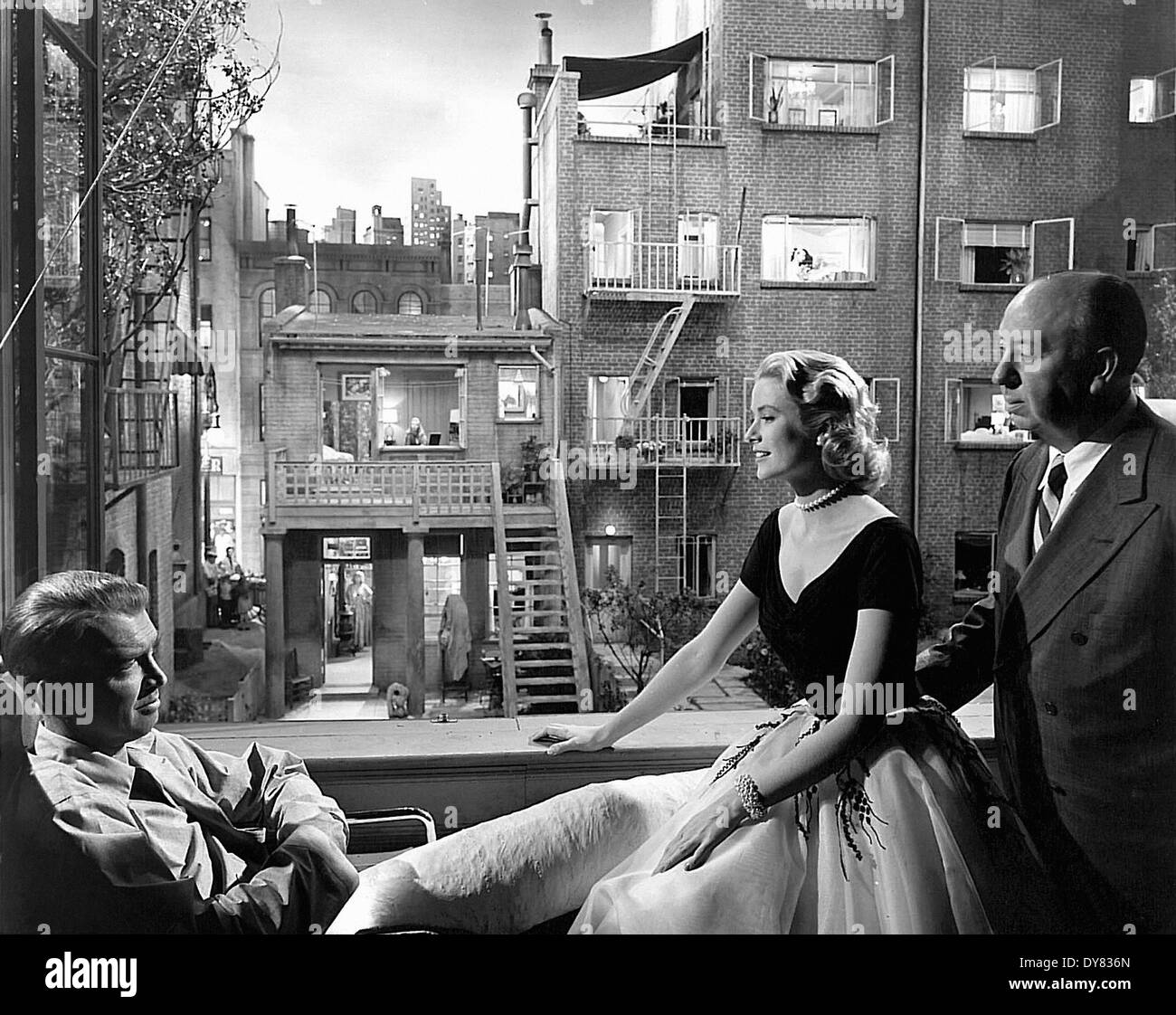 Rear Window - Grace Kelly , James Stewart - Alfred Hitchcock - Stage Photography - Director : Alfred Hitchcock - 1954 - Stock Image
